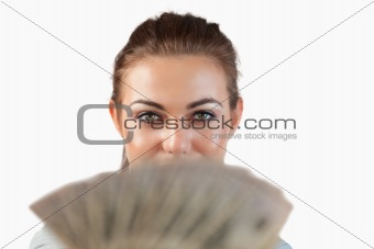 Close up of businesswoman showing bank notes