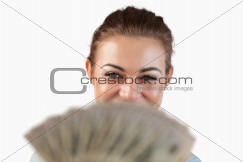 Close up of smiling businesswoman showing her bank notes