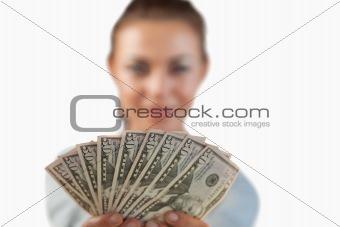 Money being shown by businesswoman