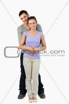 Young male holding his girlfriend