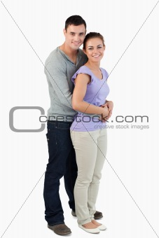 Side view of young male holding his girlfriend