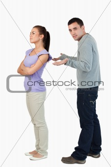 Young female giving her boyfriend the cold shoulder