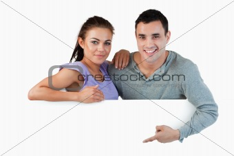 Young couple presenting advertisement