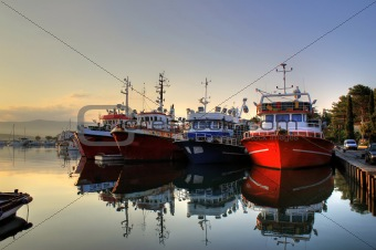 Fishing boats on early morning on calm sea