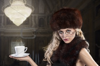 elegant fashion lady with cup of tea