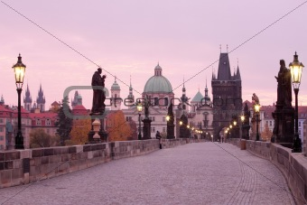 czech republic prague - charles bridge and spires of the old town at dawn