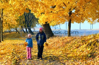 Family in autumn maple park