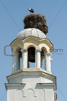 Stork in nest on dome of a church
