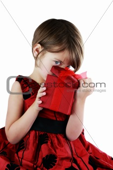 Child Peeking Into Giftbox