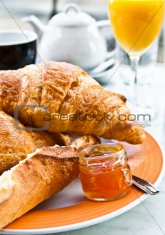 Breakfast with coffee and croissants
