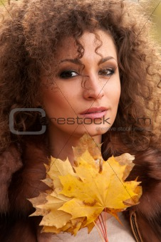 woman with leaves of the tree