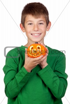 Adorable child with a pumpkin