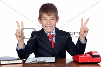Little businessman in the office doing symbol of victory