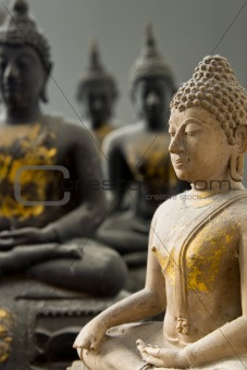 One White Stone Buddha and Three Black statue