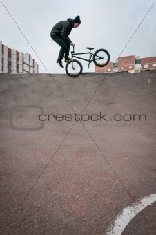 Biker doing footjam tailwhip trick