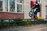 Biker doing icepick grind trick