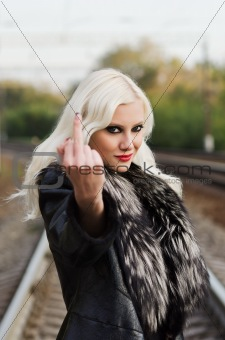Seductive young girl showing middle finger (&quot;fuck off&quot; gesture)