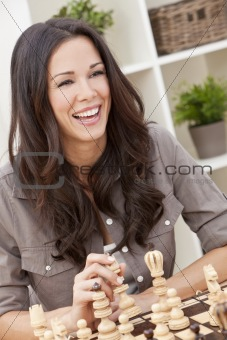 Happy Smiling Beautiful Woman Playing Chess