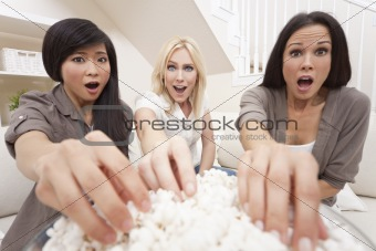 Three Beautiful Women Friends Eating Popcorn Watching Movie at H