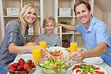 Parents Child Family Healthy Food &amp; Salad At Dining Table 