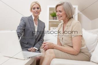 Saleswoman Advising a Senior Woman on Laptop Computer