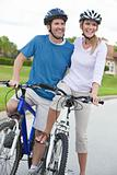 Happy Man & Woman Couple Riding Bikes