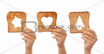 Bread slices with christmas symbols cutouts