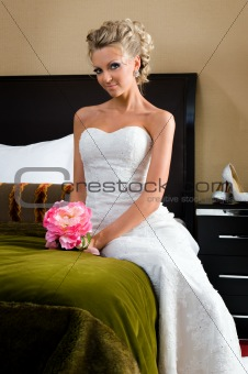 Beautiful bride in the bedroom with luxurious interior