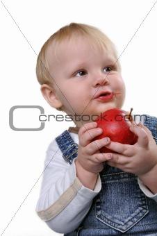 boy biting an apple