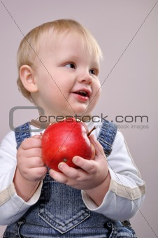 baby boy with an apple