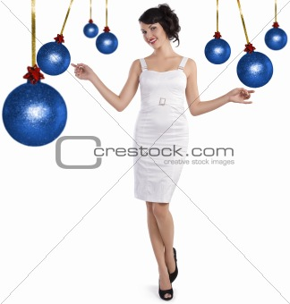 preety girl standing between the christmas ball