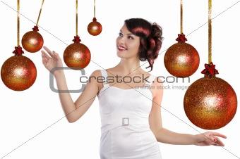preety girl playing between the christmas ball
