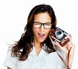 Crazy young woman with an old camera on white background