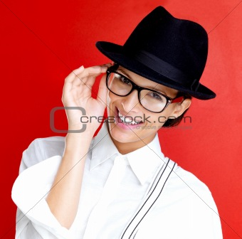 Happy young woman in glasses and hat on white