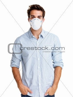 Pollution - Young man wearing a surgical mask