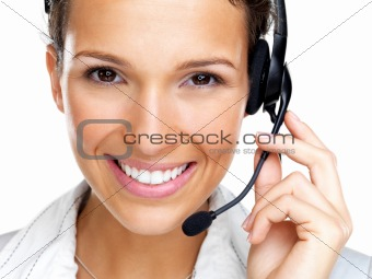 Happy young female call centre employee smiling with a headset