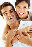 Loving young couple together with arms around