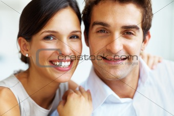 Lovely young couple smiling together