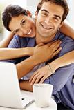 Romantic young love couple with a laptop