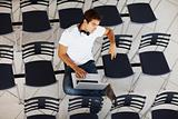 Young man sitting alone in lecture hall