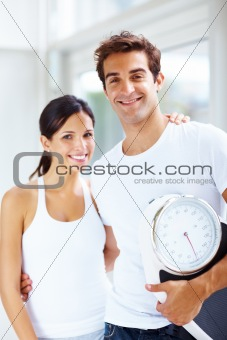 Healthy lifestyle - Young fit couple with a weight scale