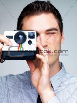 Professional young male photographer shooting pictures