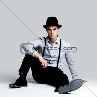 Relaxed young man posing confidently - Copyspace