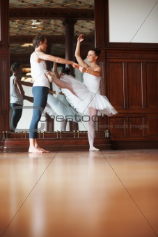 Young man dancing with his partner on floor