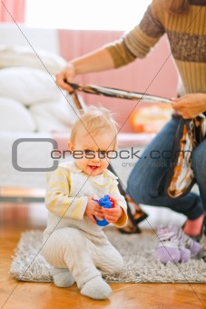 Lovely baby playing on floor