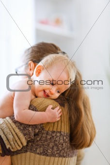 Little cute baby hanging mama