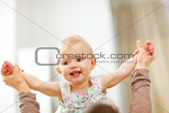 Portrait of happy playing baby