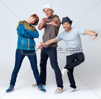Three young breakdancers standing in different poses