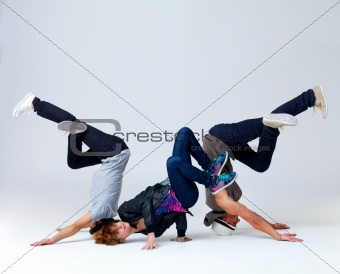 Young bboying group performing cool dance moves