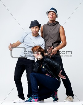 Hip hop dancers posing on grey background
